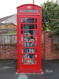 Decommissioned phone box converted into a mini-library, Whitwell, Isle of Wight, UK