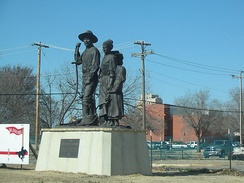 The Pioneer Family Statue by local artist, Harold Holden, outside the Cherokee Strip Regional Heritage Center.