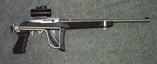 This Ruger 10/22 rifle with a pistol grip and a folding stock was classified as an assault weapon under the Federal Assault Weapons Ban.