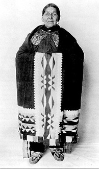 Susie Elkhair (d. 1926) of the Delaware Tribe of Indians, wearing ribbonwork shawl.