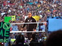 The Rock in the ring as host of WrestleMania XXVII in April 2011