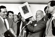 Ulysses Guimarães holding the Constitution of 1988 in his hands.