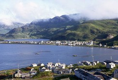 Unalaska view in 1972 with the collapsed buildings of the closed naval base in the foreground