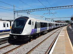 A Class 345 train in Elizabeth line livery, with temporary TfL Rail branding