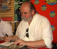 Kaluta sketching Howard the Duck on a copy of  Fear Itself: Fearsome Four, at a June 8, 2011 Midtown Comics appearance