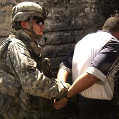 A U.S. Paratrooper from the 82nd Airborne Division makes an arrest in June 2007, during the Iraq War.