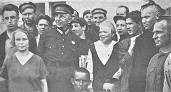 Andrei Bubnov (military uniform) and Maria Ulyanova at the meeting of the workers and peasants news correspondents 1926
