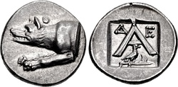 Triobol of Argos (top), and a bronze coin of King Amyntas II of Macedon (bottom).  The early Argead kings often copied the wolf of Argos' coins on their own coinage to highlight their supposed ancestry from this city.[10]