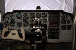 Cockpit of a 1964 Baron 55 with a mixture of original equipment and modern avionics