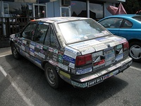 A car plastered all over with bumper stickers