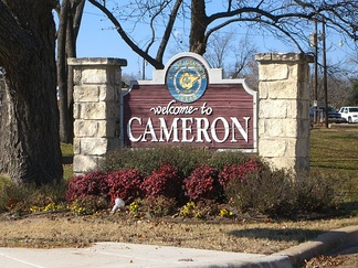 "A ""Welcome to Cameron"" sign."