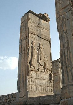 Xerxes being designated by Darius I. Tripylon, Persepolis. The ethnicities of the Empire are shown supporting the throne. Ahuramazda crowns the scene.