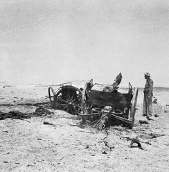 An RAF officer investigates wrecked artillery on the plateau above Habbaniya