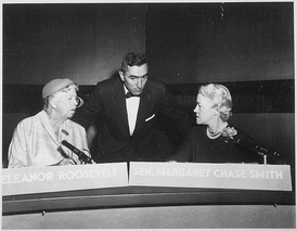 In 1956 Smith and Eleanor Roosevelt jointly appeared as the first-ever women panelists on Face the Nation. With them is the host, CBS News correspondent Stuart Novins.
