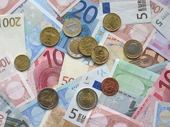 Euro coins and banknotes of various denominations
