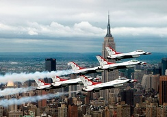 Six Thunderbird F-16s in delta formation flying near the Empire State Building.