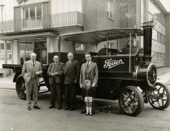 "The Foden Family, outside the Elworth factory,  c.1961. From L to R. (1) James Edwin Foden, son of William Foden. (2) William Foden, son of the founder Edwin Foden. (3) Reginal Gordon Foden, son of William Foden. (4) David Colville Foden, son of James Edwin Foden. (5) Hugh Foden, son of David Colville Foden. The vehicle is the ""Pride of Edwin"" a 5-ton Compound engined that now held by the Science Museum at their Wroughton store."