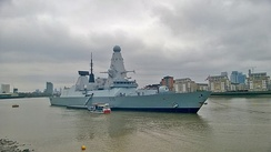 The Royal Navy Type 45 destroyer HMS Defender moored on the riverfront at Greenwich in 2015