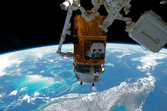 The Canadarm2 moves HTV-2 back to the nadir port of Harmony on 10 March 2011.