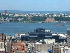 Javits Center, behind which is located New York Waterway's Midtown Ferry Terminal at Pier 79. The Weehawken Yards were at the base of the Hudson Palisades.