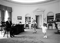 John F. Kennedy's children visit the Oval Office