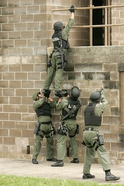 U.S. Air Force 37th Training Wing's Emergency Services Team use a team lift technique to enter a target building during training at Lackland Air Force Base, Texas on April 24, 2007.