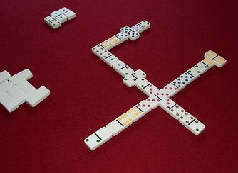Muggins played with multicolored tiles: The doubles serve as spinners, allowing the line of play to branch.