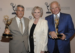 Goddard Space Flight Center Engineer Richard Nafzger, actress June Lockhart, and astronaut Buzz Aldrin accepting the Philo T. Farnsworth Emmy Award on behalf of NASA in 2009, honoring the technological innovations first used during the broadcasts of the Apollo 11 Moon landing