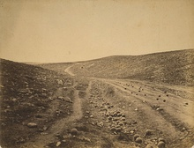 Versions of Roger Fenton's Valley of the Shadow of Death, with and without cannonballs on the road