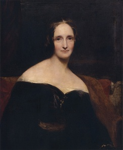 Half-length portrait of a woman wearing a black dress sitting on a red sofa. Her dress is off the shoulder, exposing her shoulders. The brush strokes are broad.