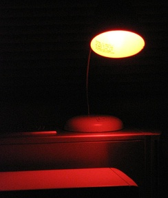 An amber (light brown) safelight for use with certain black-and-white photographic papers