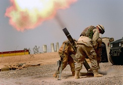U.S. troops fire mortars