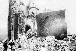 Urakami Tenshudo (Catholic Church in Nagasaki) destroyed by the bomb, the dome/bell of the church, at right, having toppled off