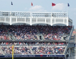 The frieze lining the roof of Yankee Stadium
