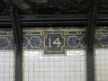 "Mosaic decoration with number ""14"" in the tile borders"