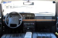 The dash of a 1993 US-market Volvo 240 Classic wagon with leather seats and wood trim