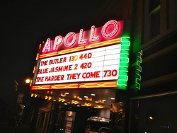 The Apollo Theater's iconic marquee at night.
