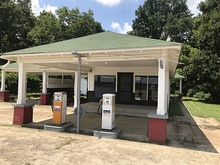 The reconstructed Ben Roy Service Station that stood next to the grocery store where Till encountered Bryant in Money, Mississippi,[181] 2019