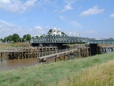 Crosskeys Bridge swing bridge on the River Nene before the mouth of The Wash, built in 1897, in the village of Sutton Bridge, south Lincolnshire