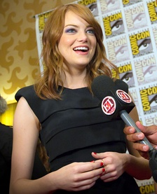 Stone at the 2011 San Diego Comic-Con International. Her hair, eyes, and husky voice have been described as her trademarks by the media.[151][152]
