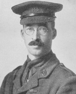 Bespectacled, mustachioed man in military uniform