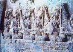 Chang players depicted on a 6th-century Sasanian relief at Taq-e Bostan.