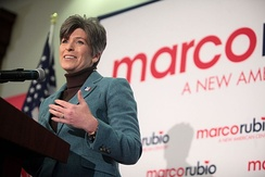 Ernst speaking about foreign policy at a campaign appearance for U.S. Senator Marco Rubio in Des Moines, Iowa.