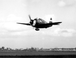 "P-47D ""Kathie"" with 75-gallon drop tank buzzes the airfield at Bodney, England"