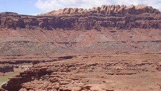 The Permian through Jurassic stratigraphy of the Colorado Plateau area of southeastern Utah is an example of both original horizontality and the law of superposition. These strata make up much of the famous prominent rock formations in widely spaced protected areas such as Capitol Reef National Park and Canyonlands National Park. From top to bottom: Rounded tan domes of the Navajo Sandstone, layered red Kayenta Formation, cliff-forming, vertically jointed, red Wingate Sandstone, slope-forming, purplish Chinle Formation, layered, lighter-red Moenkopi Formation, and white, layered Cutler Formation sandstone. Picture from Glen Canyon National Recreation Area, Utah.