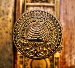 "A doorknob of the Salt Lake Temple bearing an image of a beehive and carrying the inscription, ""Holiness to the Lord"""