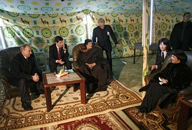 During his November 2008 visit to Russia, Gaddafi pitched his Bedouin tent in the grounds of the Moscow Kremlin. Here he is joined by Russian Prime Minister Vladimir Putin and French singer Mireille Mathieu.