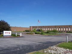Former manufacturing facility in Henrietta, New York, constructed in the 1960s and sold to Harris RF Communications in 2010