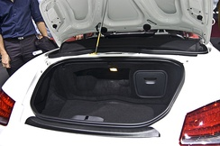The open trunk in the rear of a Porsche Boxster