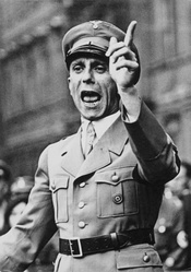Goebbels speaks at a political rally (1932). This body position, with arms akimbo, was intended to show the speaker as being in a position of authority.[62]
